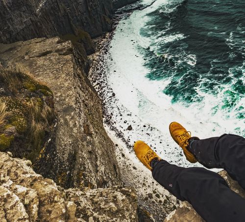Fear or freedom? Cliffs Cliffsofmoher Cliffs Of Moher  Travel Photography Traveling Landscape_Collection Landscape_photography Brave Braveness Low Section Standing Beach Sand Human Leg Men Shoe Shadow High Angle View Directly Above Footwear Slipper  Pair Trousers Shore Feet