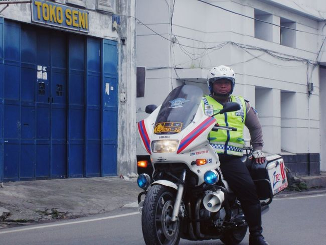 Waiting Game A Police Officer guarding a marching band I met in Kesawan, Medan INDONESIA. Transportation Real People Outdoors Land Vehicle One Person Day Building Exterior Adults Only South East Asia Police Uniform Police Motorcycle Police Only