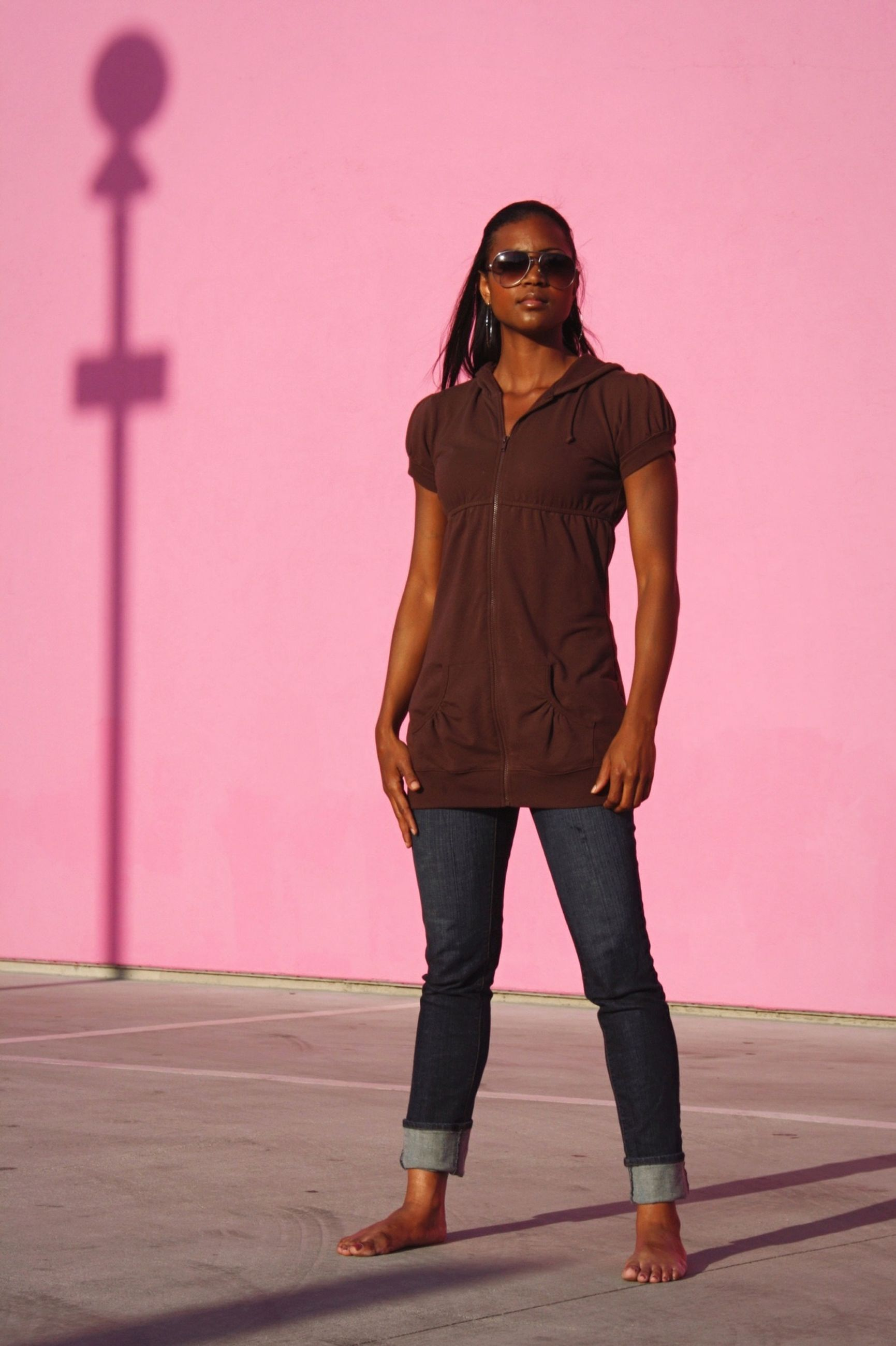 young adult, standing, full length, casual clothing, lifestyles, front view, young women, wall - building feature, leisure activity, fashion, looking at camera, person, three quarter length, portrait, architecture, built structure, fashionable, hands in pockets