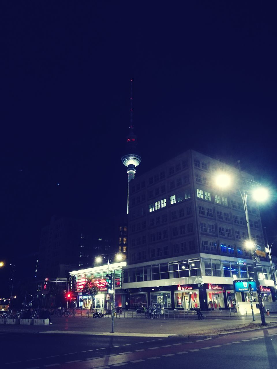 architecture, built structure, building exterior, night, illuminated, communication, city, travel destinations, outdoors, television tower, sky, clear sky, no people, modern
