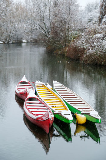 Multi colored boat in lake