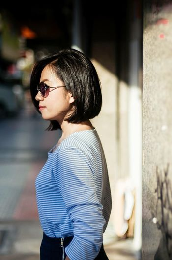 EyeEm Selects Real People One Person Young Adult Sunglasses Fashion Focus On Foreground Standing Young Women Side View Beautiful Woman Eyeglasses  Lifestyles Portrait Day Outdoors Close-up People