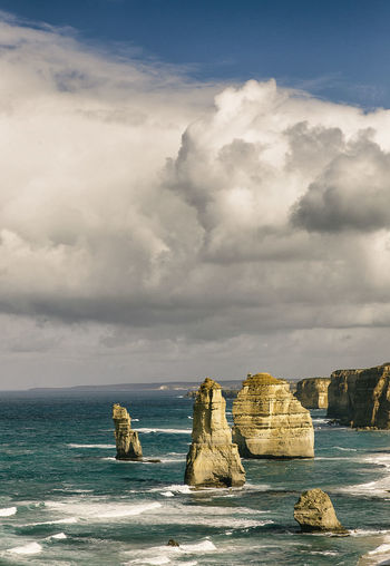 the twelve apostles,australia Horizon Over Water Land Horizon Rock - Object Beach Stack Rock Nature Tranquil Scene No People Outdoors Cloud - Sky Sky Scenics - Nature Sea Rock Water Solid Beauty In Nature Rock Formation Tranquility Day