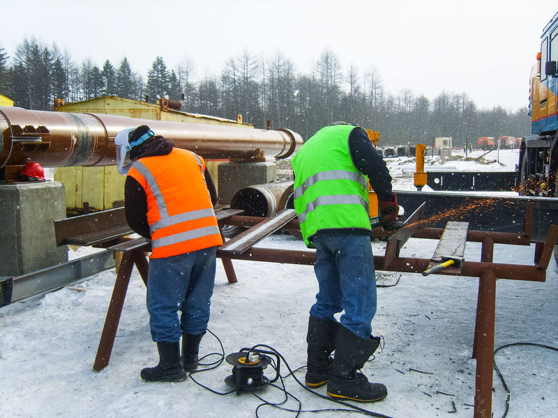 Cold Temperature Construction Site Construction Worker Day Full Length Hardhat  Industry Maintenance Engineer Manual Worker Men Occupation Outdoors Protective Workwear Real People Reflective Clothing Repairing Repairman Snow Standing Togetherness Two People Warm Clothing Weather Winter Working