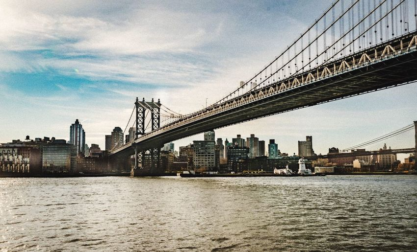 Architecture Bridge - Man Made Structure Connection Built Structure River Sky Suspension Bridge City Building Exterior Cloud - Sky Transportation Water Outdoors Travel Destinations Waterfront Travel Cityscape Day Skyscraper No People Beauty Photooftheday Photography Landscape NYC