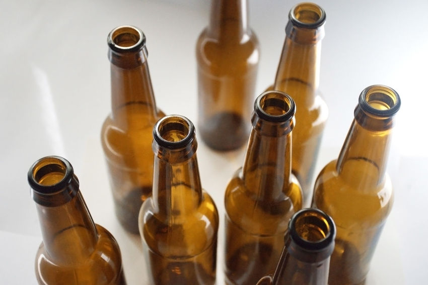 Glass beer bottles Beer Beer Bottle Alcohol Beer Bottle Bottle Brown Container Drink Food And Drink Glass - Material High Angle View Large Group Of Objects Studio Shot