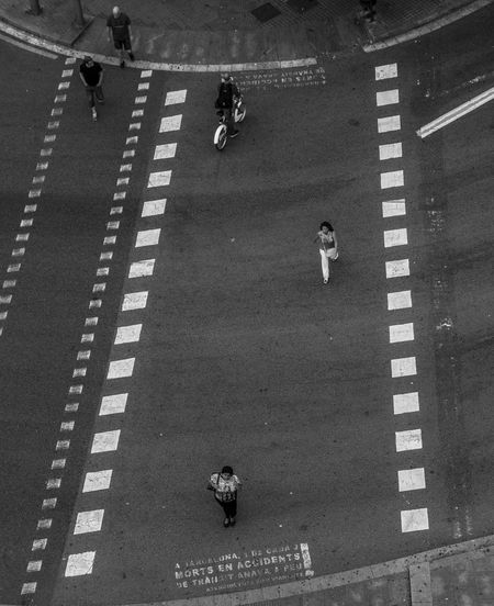 High angle view of men playing on road