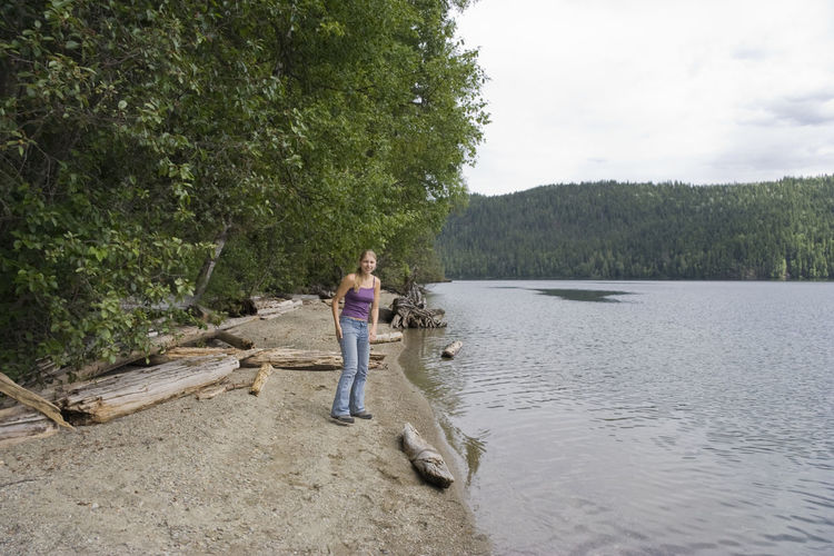 Young woman on a lakeshore - Clearwater Lake, Wells Gray Provincial Park, British Columbia, Canada Beach Beach Photography Beachphotography British Columbia Canada Casual Clothing Clearwater Lake Forest Full Length Hiking Hikingadventures Lake Lake View Lakeshore One Woman Only One Young Woman Only Treelined Vacations Walking Water Wells Gray Provincial Park Wilderness Woman Young Woman Young Women