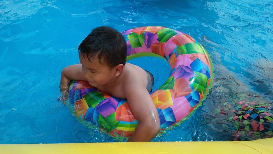 High angle view of boy in swimming pool