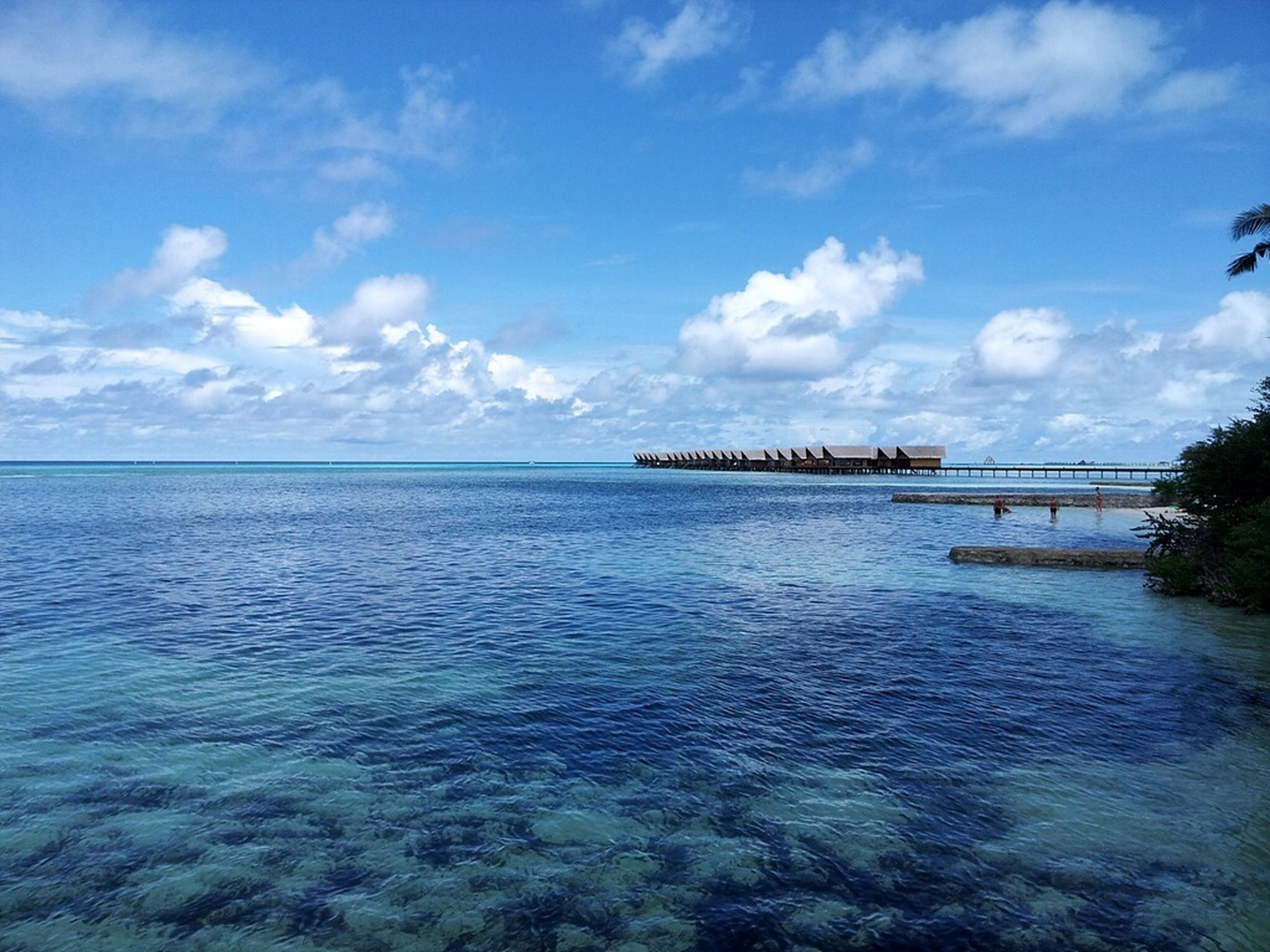 water, sea, sky, tranquil scene, tranquility, scenics, cloud - sky, waterfront, beauty in nature, horizon over water, cloud, nature, blue, rippled, built structure, pier, idyllic, architecture, calm, day