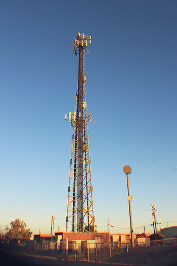 Radio Tower Antenna - Aerial Architecture Blue Broadcasting Built Structure Clear Sky Communication Connection Day Drilling Rig Global Communications Industry Information Medium Low Angle View Metal No People Outdoors Satellite Dish Sky Tall - High Technology Telecommunications Equipment Tower Wireless Technology