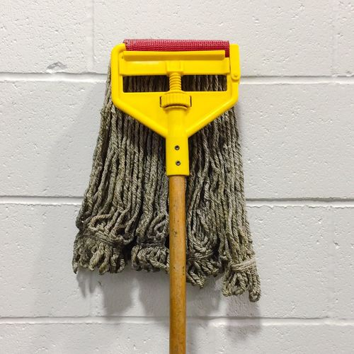 Mop against wall