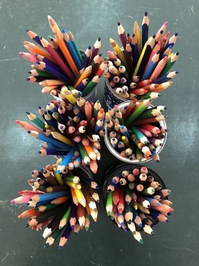 Crayons Abundance Arrangement Art And Craft Art And Craft Equipment Choice Close-up Collection Colored Pencil Colorful Container Creativity Directly Above High Angle View Indoors  Large Group Of Objects Multi Colored No People Pencil Still Life Table Variation Writing Instrument