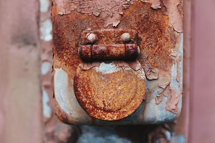 Rusty Brown Anthropomorphic Face Run-down Textured  Nut - Fastener Metal Rough Close-up Weathered
