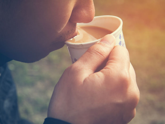 Close-up of man drinking tea