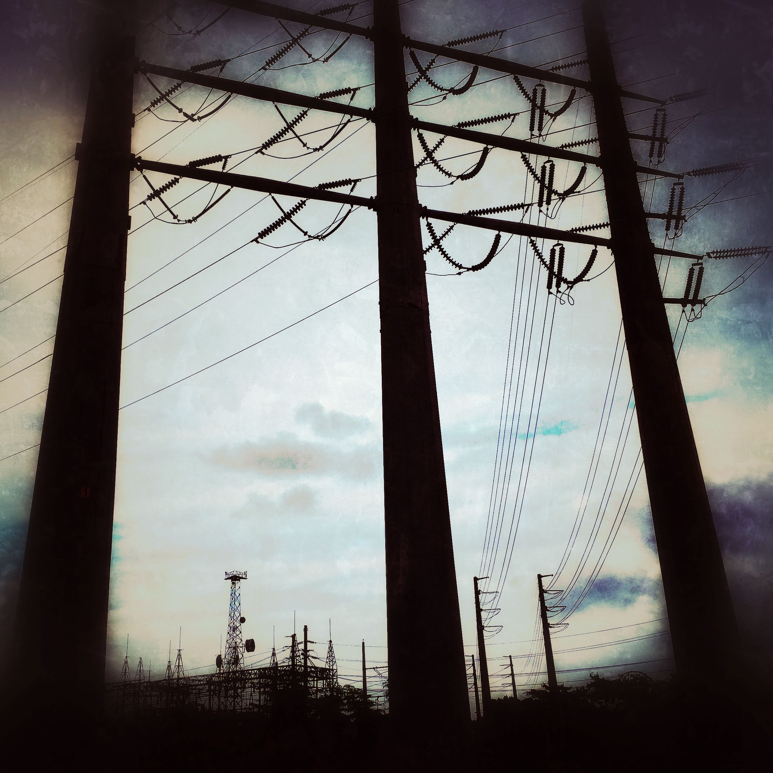 low angle view, silhouette, sky, power line, electricity pylon, power supply, electricity, fuel and power generation, connection, cable, dusk, cloud - sky, bare tree, technology, tree, nature, cloud, sunset, outdoors, cloudy