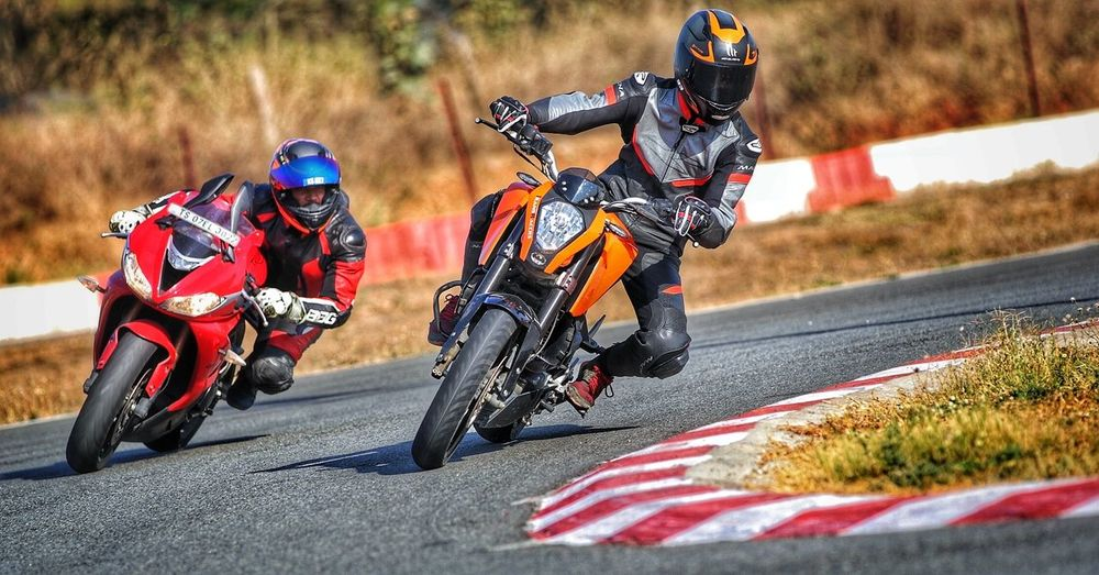 Motorcycle Riding Speed Motorcycle Racing Transportation Sports Track Motorsport Two People Biker Motocross Day Adults Only Road Adventure Outdoors Sports Race People Sports Clothing Adult Duke200 Triumph Daytona 675R KTMRacing Triumphmotorcycles
