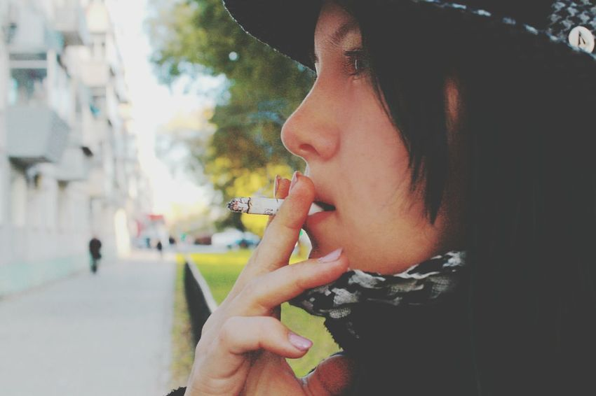 Young Women Smoking - Activity One Person Women One Woman Only One Young Woman Only City Young Adult Only Women Adults Only People