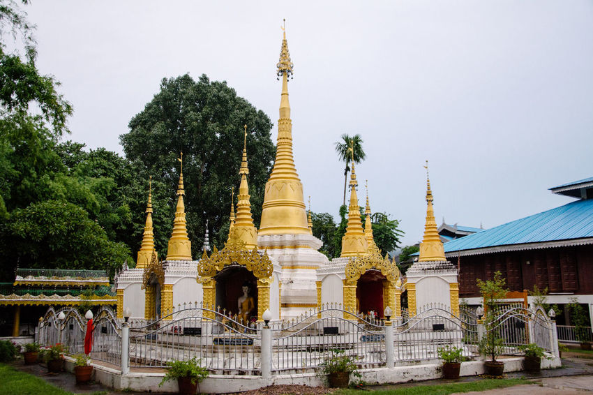 Architectural Feature Architecture Building Exterior Built Structure Clear Sky Culture Famous Place Gold Colored Golden History Mosque Outdoors Person Place Of Worship Religion Spire  Spirituality Statue Stupa Temple - Building Tourism Tower Travel Destinations Tree