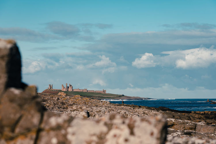 Sea Beach Horizon Over Water Nature Sand Sky Travel Destinations Outdoors Blue Day Tranquility Vacations Landscape People Water Clear Sky Adult Beauty In Nature Nautical Vessel Wave Dustanburgh Castle