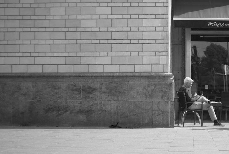 Men sitting outdoors