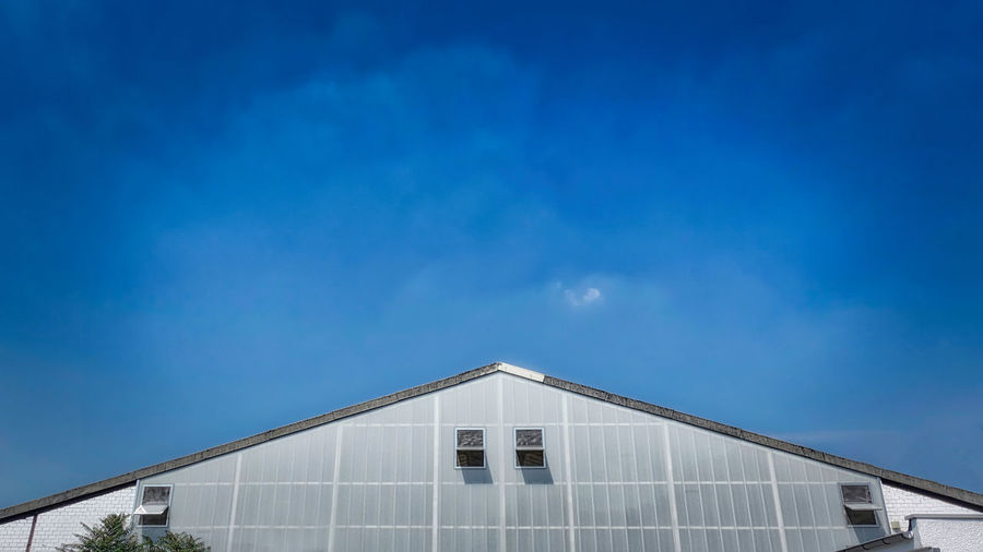 Architecture Blue Building Building Exterior Built Structure Cloud - Sky Copy Space Day Glass - Material High Section House Low Angle View Modern Nature No People Outdoors Pediment Sky Sunlight White Color