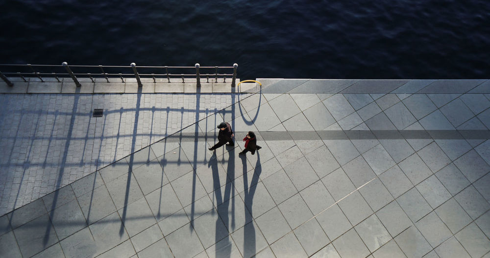 High angle view of people walking on promenade