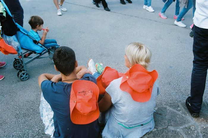 35mmfilmphotography Analogue Photography Adult Anloglove Boys Child Childhood City Community Outreach Day Directly Above Girls High Angle View Men Outdoors People Real People Road Standing Street Togetherness Volunteer
