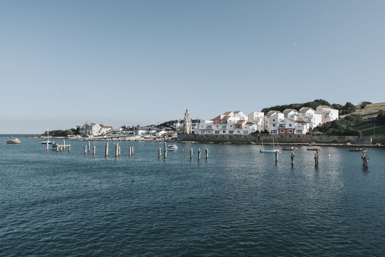 Swanage United Kingdom Coast Village Town Sea Ocean Beach Clear Sky Water Architecture Built Structure Waterfront Sky Blue Day Outdoors Scenics - Nature TOWNSCAPE City No People Nature