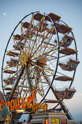Amusement Park Amusement Park Ride Arts Culture And Entertainment Built Structure Circle Clear Sky Day Enjoyment Fairground Ferris Wheel Geometric Shape Large Leisure Activity Low Angle View Outdoors Sky