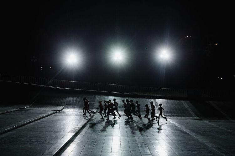 People running on floor at night