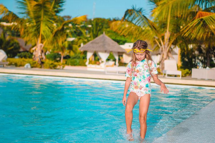 Portrait of woman in bikini swimming pool