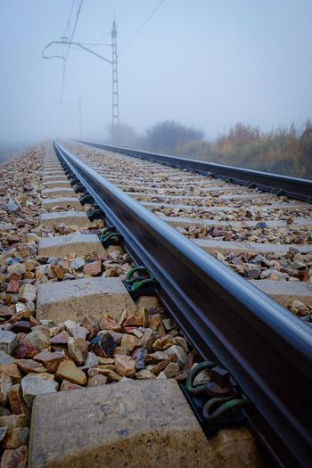 Surface level of railroad track against sky