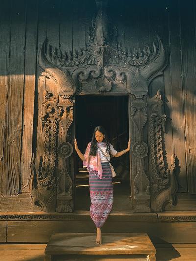 Full length of woman standing at doorway