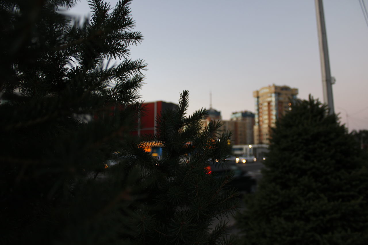 ILLUMINATED CITY AGAINST SKY AT DUSK