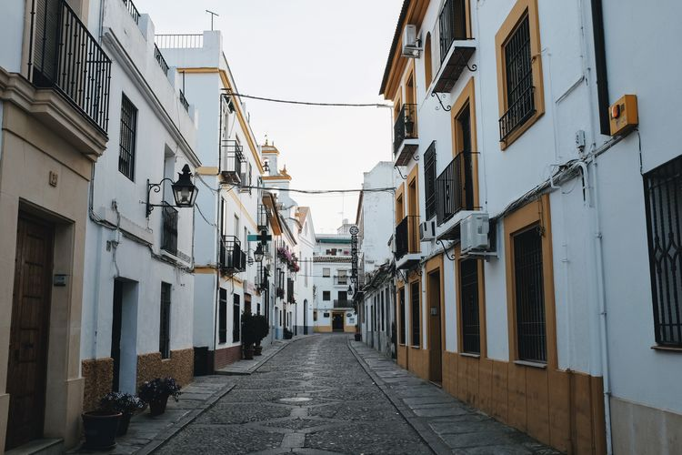 Alley Architecture Building Building Exterior Built Structure City Day Diminishing Perspective Direction Footpath House Long Narrow Nature No People Outdoors Residential District Sky Street The Way Forward Window