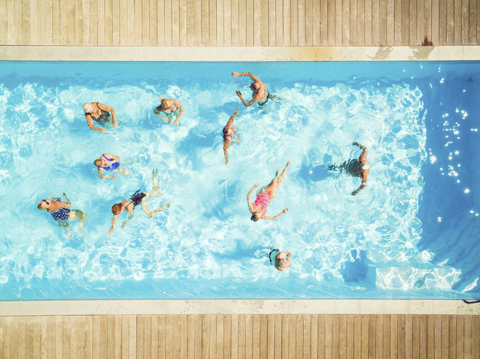 Group of people swimming in pool