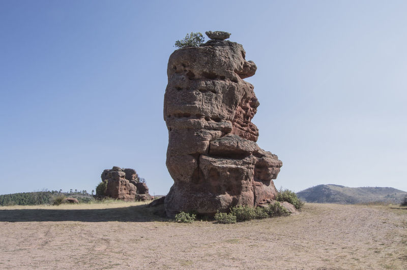 Stack Rock On Field Against Clear Blue Sky At Parque Natural Del Alto Tajo