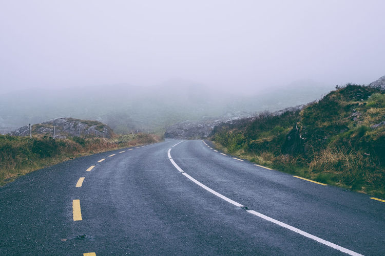 Ireland Asphalt Day Dividing Line Fog Journey Landscape Mountain Nature No People Outdoors Ring Of Kerry Road Scenics Sky The Way Forward Transportation Winding Road