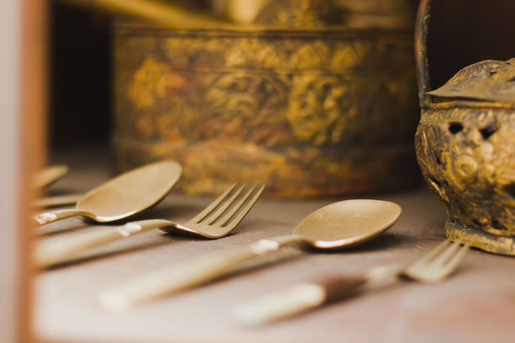 Close-up of spoons and forks on table
