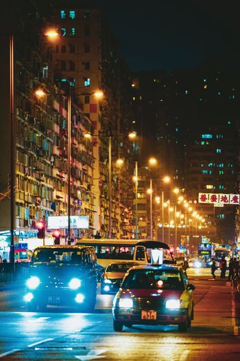 Reframinghk Nightshooters Discoverhongkong Street Photography Transportation City Mode Of Transportation Street Illuminated Car Night Architecture Motor Vehicle Built Structure Land Vehicle Building Exterior Street Light Traffic Motion Road City Street City Life Outdoors Lighting Equipment