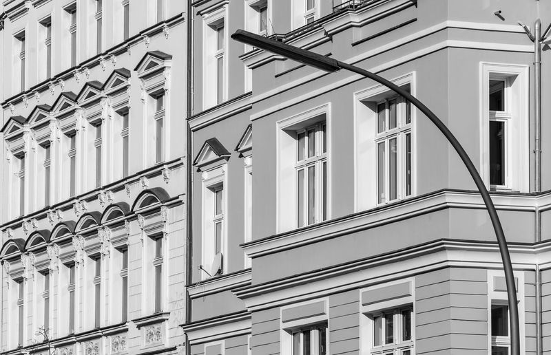 Black And White Urban Street Photography Street Lamp Bulding Streetwise Photography Old Residential District Building Exterior Built Structure Architecture Building Low Angle View No People Window Day Full Frame City Outdoors Nature Backgrounds Side By Side Balcony In A Row Sky Pattern Glass - Material Apartment