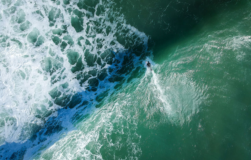 Aerial view from a surfer in a Surf Spot. Drone photo Water High Angle View Sea Day Nature Motion Outdoors Sport Ericeira Surf Life Wave Ocean Surfer Surfing Paradise Top View Dronephotography Big Waves Surf Spot Summer Travel Outdoor Lifestyles Freedom Surf Board Beach Bay