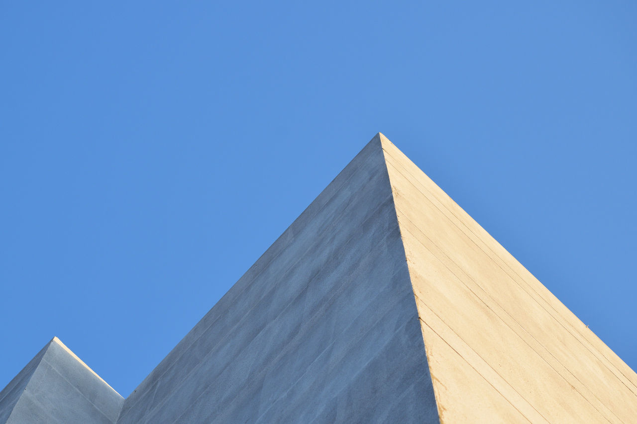low angle view, pyramid, built structure, clear sky, copy space, architecture, blue, travel destinations, day, ancient, no people, outdoors, ancient civilization, nature, sky