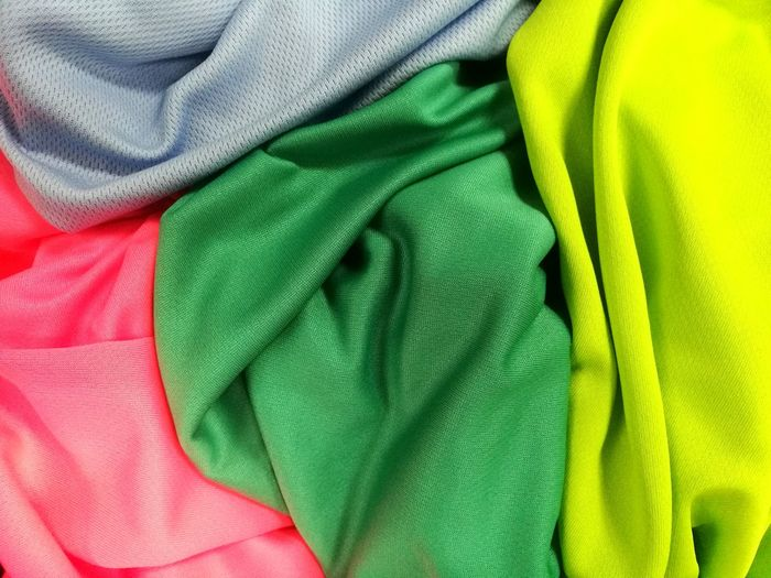 Colorful fabric Backgrounds Textile Crumpled Textured  Close-up Green Color Cloth Satin Silk Smooth Man Made Textile Wrinkled Colorful Fabric Drying Clothesline