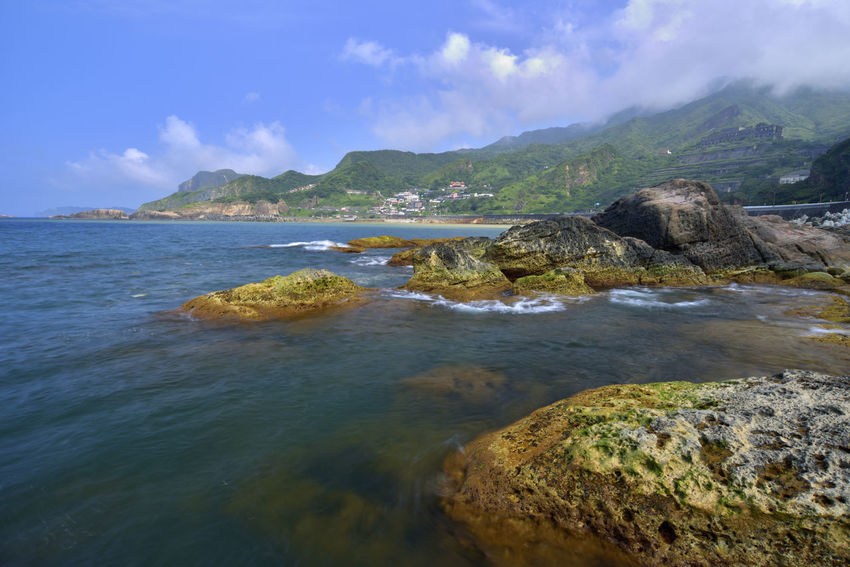 The northeast corner of Taiwan's New Taipei City is a scenic spot suitable for sightseeing. Jinguashih Northeast Coast Taiwan Beach Beauty In Nature Cloud - Sky Day Idyllic Land Mountain Nature New Taipei City No People Outdoors Rock Rock - Object Ruifang Scenics - Nature Sea Shallow Sky Solid Tranquil Scene Tranquility Water