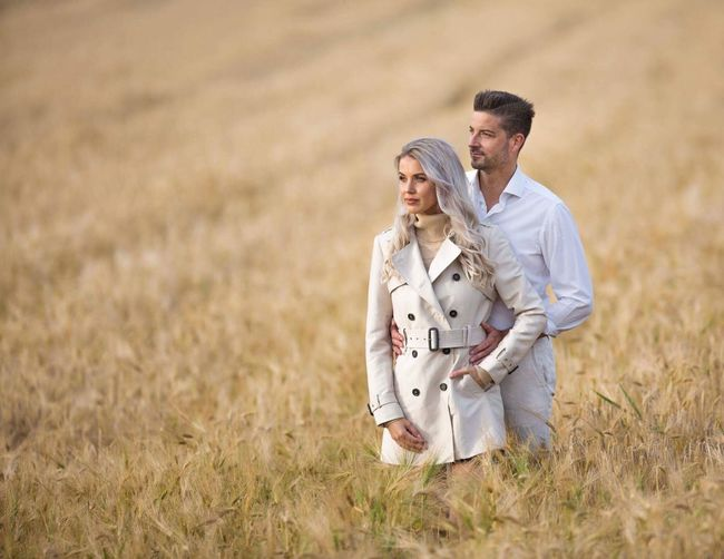 Love in fields of gold Fields Fields Of Gold Adult Nature Couple - Relationship Grass Land Landscape Two People Togetherness Love Happiness