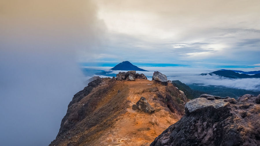 View from Mount Sibayak, Medan, Indonesia Sinabung Beauty In Nature Cloud - Sky Day Fog Geology Landscape Mist Mountain Nature No People Outdoors Rock - Object Scenics Sky Tranquility Travel Destinations Volcanic Landscape Volcano