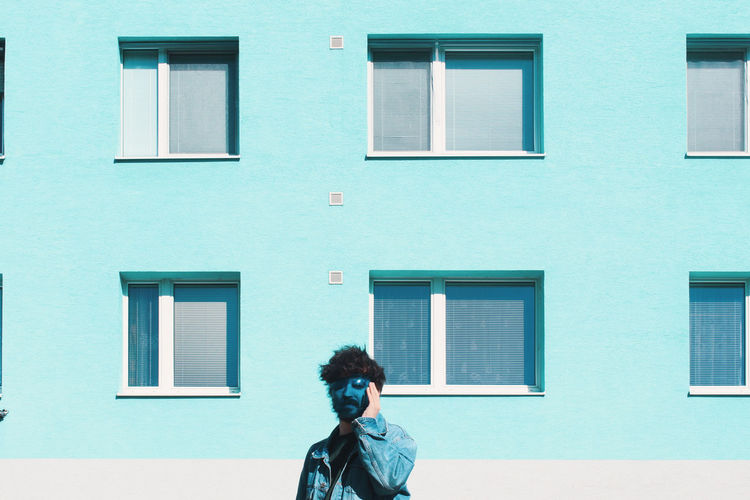 Blue Mask City Window Men Curly Hair Architecture Building Exterior Built Structure Window Box Residential Structure Exterior Building Residential Building Posing
