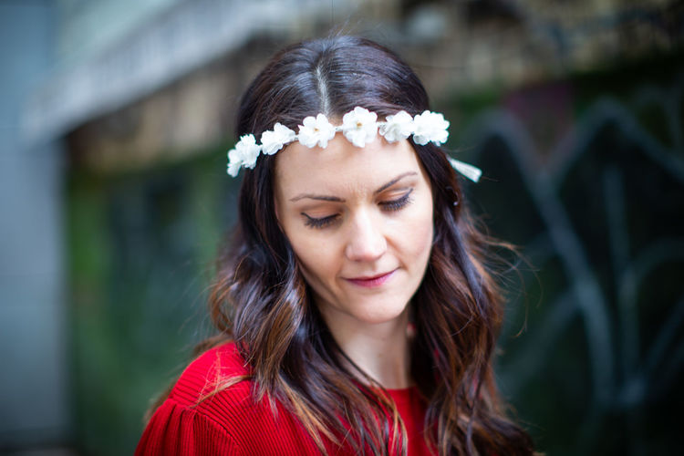 Headshot One Person Portrait Hair Long Hair Hairstyle Brown Hair Beautiful Woman Women Focus On Foreground Day Beauty Adult Young Adult Looking Down Close-up Black Hair Looking Real People Outdoors Wearing Flowers Teenager